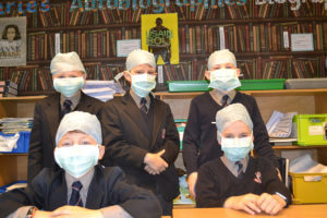 boys in surgical masks